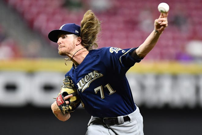 Brewers closer Josh Hader overcomes a pair of two-out hits against the Reds in the ninth inning to pick up his 36th save of the season.