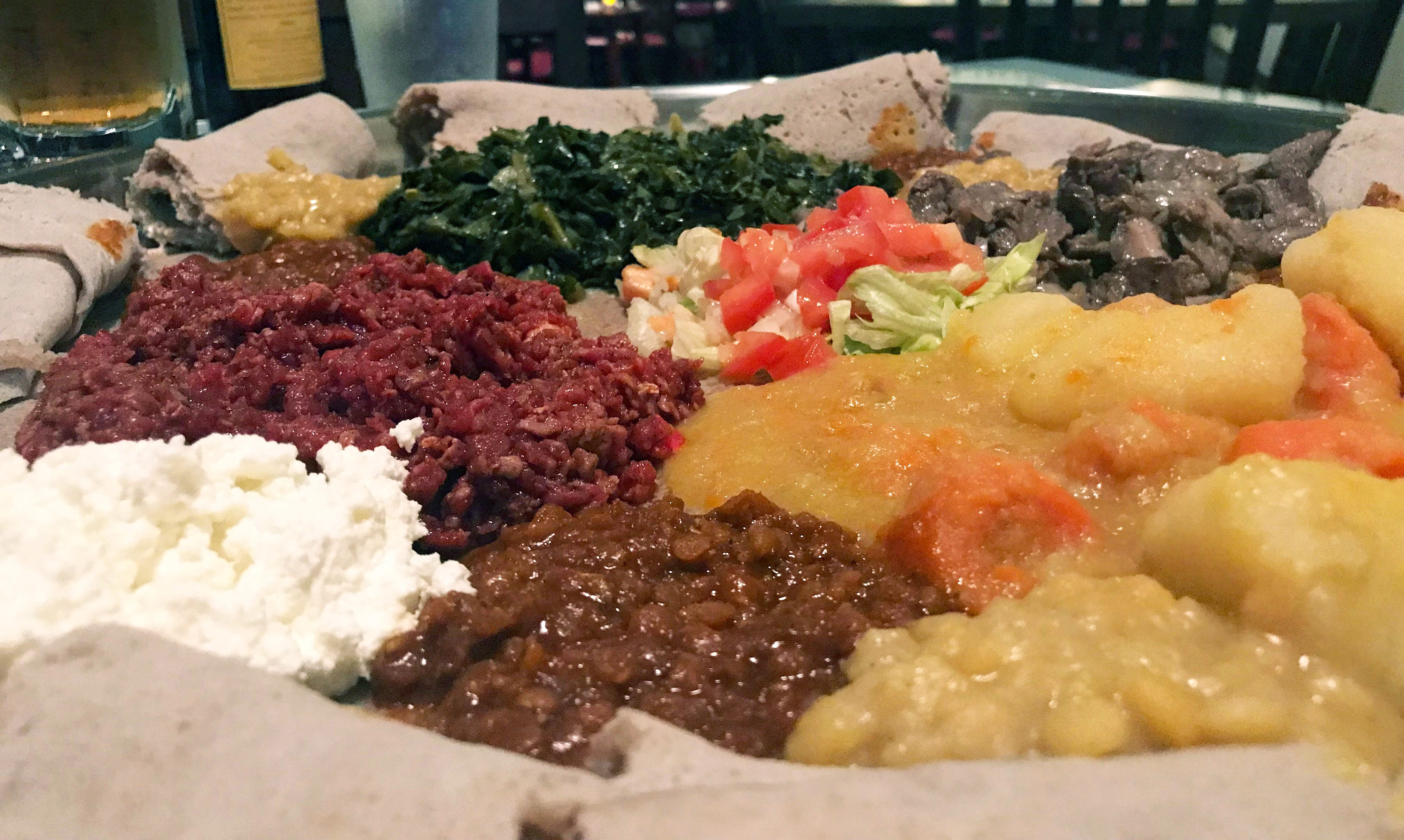 Stews and sautés are served on injera, a sourdough flatbread, at Ethiopian Cottage, 1824 N. Farwell Ave. The menu has many meat and meatless options.