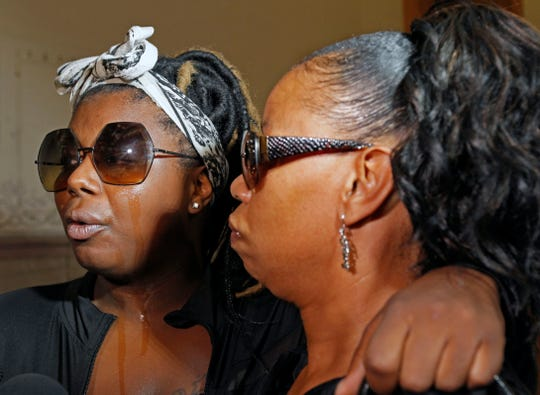 Wanona Thomas, left, the sister of Jasmine Banks, who was killed when she drove into the crossfire of two people shooting at each other across a north side street, and their mother, Ronica Banks, appeal Wednesday to residents to stop the violence in Milwaukee. They were at City Hall during a news conference of Community Task Force MKE.