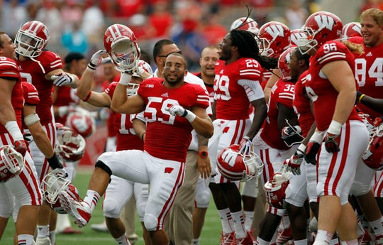 "Wisconsin's teammates were in a good mood in the fourth quarter to dance to ""Jump Around"" as the Badgers led by 48 points over the Tennessee Tech Golden Eagles at Camp Randall Stadium on Sept. 7, 2013."
