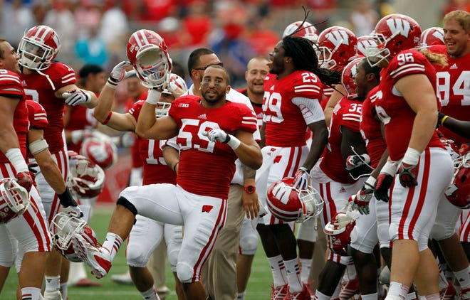 """Wisconsin's teammates were in a good mood in the 4th quarter up by 48 points dance to """"Jump Around"""" as the Wisconsin Badgers take on Tennessee Tech Golden Eagles at Camp Randall Stadium."""