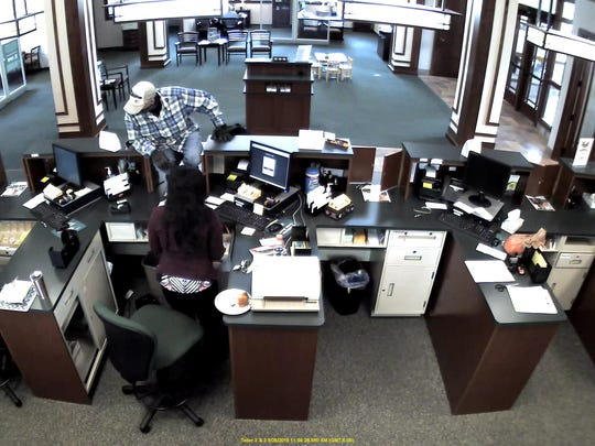 Surveillance video shows the suspect in a robbery at Waukesha State Bank, 18300 W. Capitol Drive, Sept. 25.