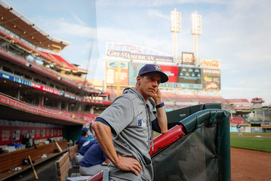 Milwaukee Brewers manager Craig Counsell takes to the top of the dugout steps in Cincinnati before a game against the Reds.