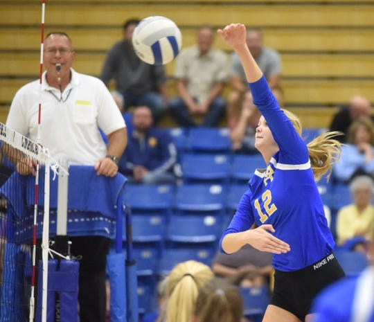 Mountain Home's Reanna Dodge swings during the Lady Bombers' sweep of Marion on Tuesday night.