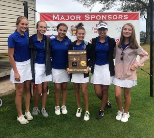 Mountain Home Lady Bomber golfers (from left) Lauren Loving, Kennedy Wyatt, Ella Brashears, Sydney Czanstkowski, Reagan Hasselwander and Madilyn Smith pose with the 5A-East Conference championship trophy on Tuesday.