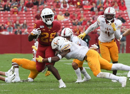 Iowa State  running back Rory Walling (29) is tackled by the ULM defense at Jack Trice Stadium. The Cyclones beat the Warhawks 72 to 20.