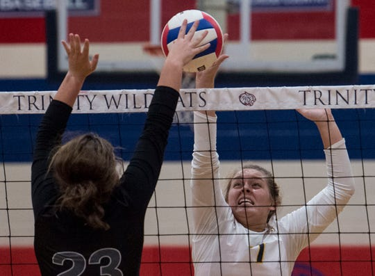 St. James' Merrily Capouya (7) hits the ball during a volleyball tournament at Trinity Presbyterian School in Montgomery, Ala., on Tuesday, Sept. 24, 2019.