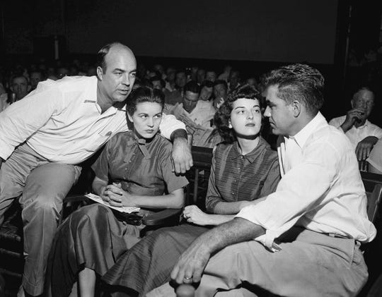 FILE - In this Sept. 23, 1955, file photo, J.W. Milam, left, his wife, second from left, Roy Bryant, far right, and his wife, Carolyn Bryant, sit together in a courtroom in Sumner, Miss. Bryant and his half-brother Milam were charged with murder but acquitted in the kidnapping and torture slaying of 14-year-old black teen Emmett Till in 1955 after he allegedly whistled at Carolyn Bryant. The government is still investigating the brutal slaying of the black teenager that helped spur the civil rights movement more than 60 years ago.