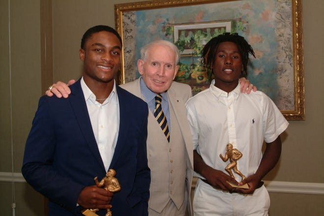 Former SEC head referee General Dick Burleson was the featured speaker at the September 24 meeting of the Montgomery Quarterback Club. With Burleson are last week's players of the week, Austin Gavin from St. James School and Demarshia Davis from Robert E. Lee High School
