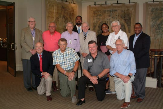 Several Veterans were on hand to welcome General Dick Burleson to the Montgomery Quarterback Club. Kneeling from left: Bryan Morgan, Steve Schwartz, Bill Havron and Lloyd Faulkner. Standing from left: Ray Warren, Pete Pederson, Harry Nelson, Saladin Anderson, Burleson, Kelli Gavin, Larry Brittain and Dex McCain.