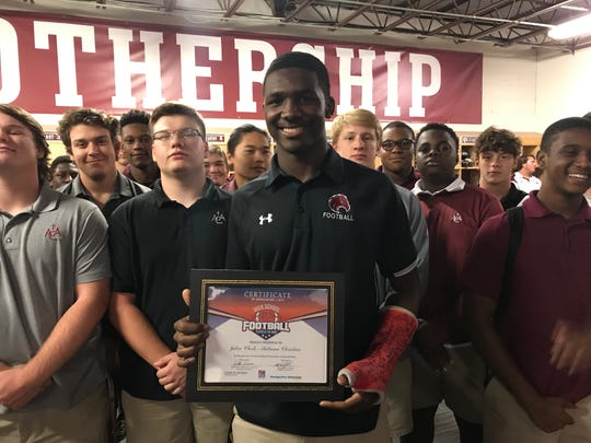 Alabama Christian quarterback Jalen Clark poses with his Week 5 ASE Credit Union player of the week award.