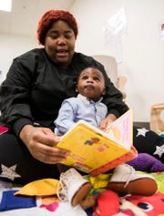 Teacher Sharonda Lewis-Hall reads to a student at James Rushton Early Learning Center in Birmingham, Ala., on Thursday, Sept. 12, 2019.