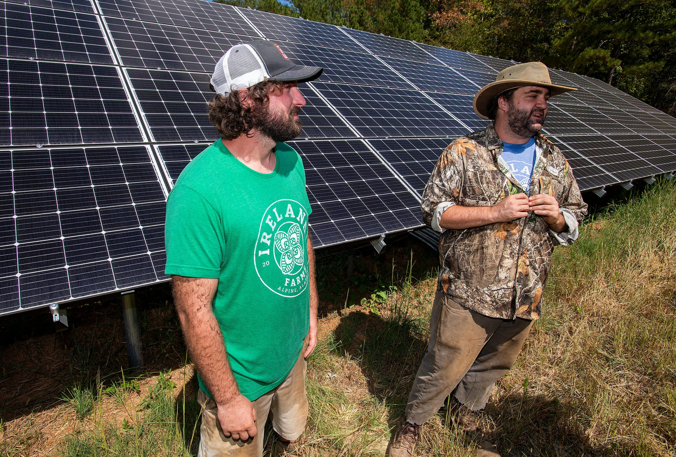 Hollin Williams, left, and Scott Ireland, right, discuss the solar panels at Ireland Farms in Alpine, Ala., on Wednesday September 25, 2019.