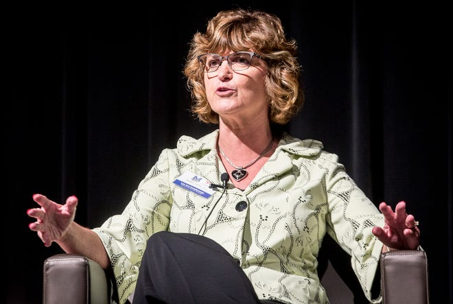 Lee Ann Kwiatkowski, CEO of the school district, speaks about problem solving during an academic innovation summit at the Horizon Convention Center Wednesday afternoon.