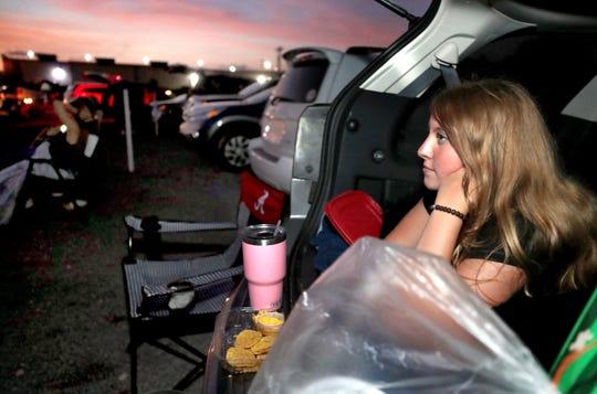 Skyler Schmidt snacks on an order of nachos while watching The Lion King at Moonlite Drive-In in Woodbury in July 2019.
