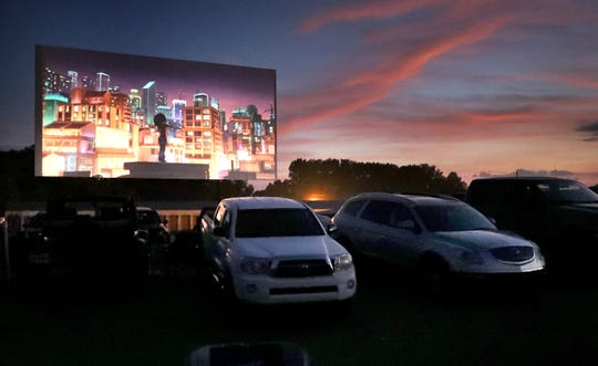 Movie trailers begin as the sun sets at the Moonlite Drive-In in Woodbury during the summer 2019 season. The theater is slated to open for the 2020 season on Friday, May 8.