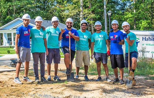Build group from Orthodox Christian Campus Ministries at Habitat for Humanity's Building on Faith Build Day in Fairview on Sept. 14, 2019.