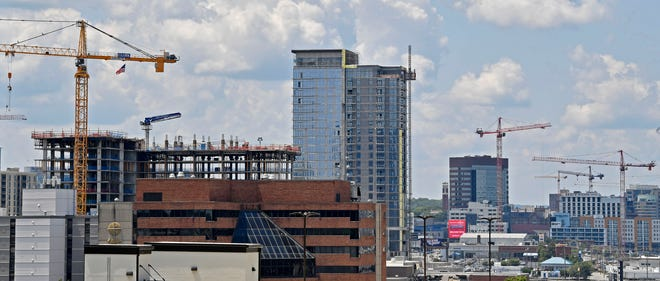 Cranes dot the Nashville skyline from the Nashville Yards construction looking West Wednesday, July 24, 2019, in Nashville, Tenn.