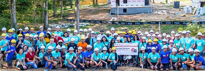 Over 100 volunteers participated in Habitat for Humanity's Building on Faith Build Day in Fairview on Sept. 14, 2019.