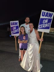 LaCrystal and Steven Ferguson, pictured with their daughter, Bailey, went straight to the picket line in Spring Hill after their wedding on Sept. 21. The UAW members, who met at the Spring Hill plant, joined thousands of other GM employees across the U.S. in the strike.