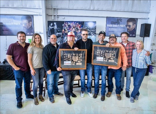 """Eric Church, center, celebrates No. 1 song """"Some of It"""" with, from left, SeaGayle Music's Brandon Gregg, Emily Witters and Marc Driskill, co-writers Bobby Pinson and Clint Daniels, plus SeaGayle Music's JD Groover, Chris DuBois and Kim Wiggins."""