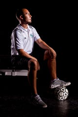 Gulf Coast High School soccer coach, Alan Scott, poses for a portrait in the school's weight room in 2013. Scott helped lead his team to the school's first state championship in 2013.