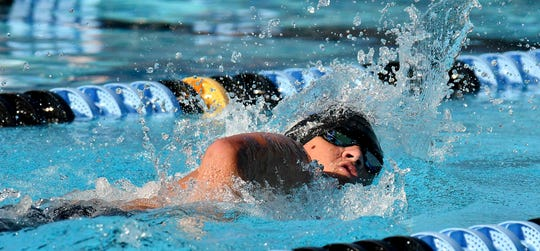 Evangelical Christian's Brendan Peacock during the boys 200 yard Freestyle during the Private 8 Conference swimming meet featuring small high schools from Collier and Lee counties in Naples, Wednesday, Sept. 25, 2019.