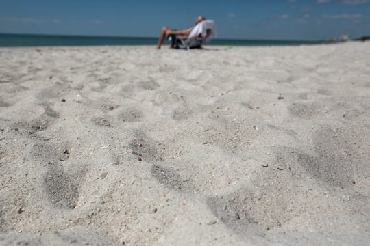 Lot Arredondo lies on a beach chair at the Park Shore Beach on Wednesday, Sept. 25, 2019, in Naples. Collier County plans to renourish 2.5 miles of beach by hauling in 165,000 tons of sand to Clam Pass, North Park Shore and Park Shore beaches.
