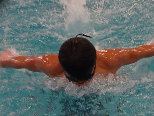 Noah Fuller, a sophomore at Marburn Academy, practices the butterfly Tuesday for the Licking County Family YMCA Sharks.