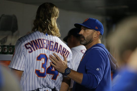 Sep 24, 2019; New York City, NY, USA; New York Mets manager Mickey Callaway (right) talks to starting pitcher Noah Syndergaard (34) before pinch hitting for him during the fifth inning against the Miami Marlins at Citi Field.