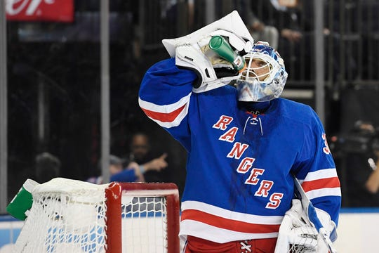 New York Rangers goaltender Henrik Lundqvist (30) takes a drink of water during a break in the first period against the New York Islanders at Madison Square Garden.
