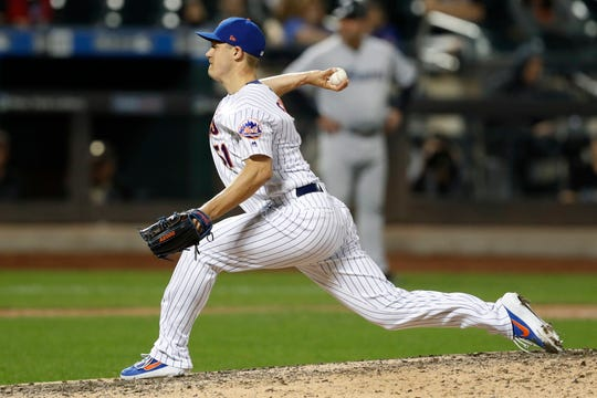New York Mets relief pitcher Paul Sewald winds up during the 11th inning of the Mets' 5-4 win win over the Miami Marlins in a baseball game Tuesday, Sept. 24, 2019, in New York.