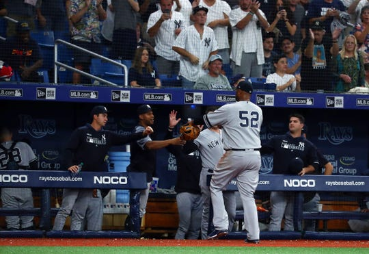 Sep 24, 2019; St. Petersburg, FL, USA; New York Yankees starting pitcher CC Sabathia (52) is congratulated by teammates at the end of the fourth inning against the Tampa Bay Rays at Tropicana Field. Mandatory Credit: Kim Klement-USA TODAY Sports