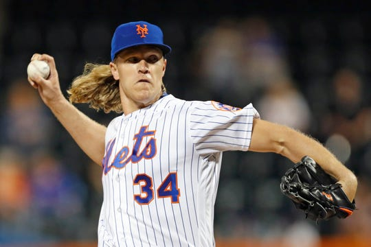 New York Mets starting pitcher Noah Syndergaard winds up during the first inning of the team's game against the Miami Marlins, Tuesday, Sept. 24, 2019, in New York.