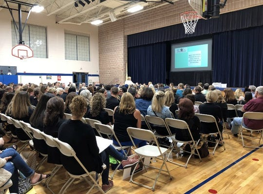 Parents and teachers fill multi-purpose room at Bogart School in Upper Saddle River for Board of Education vote on teacher contract fact-finder report.