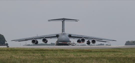 A Air Force C5 cargo plane on the runway at Dover Air Force base.  Dover Air Force Base houses the military mortuary at in Delaware where the remains of America's military who have fallen arrive and are prepared before being released to their families.