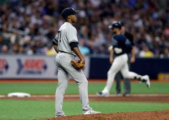 New York Yankees relief pitcher Stephen Tarpley reacts as Tampa Bay Rays' Kevin Kiermaier, right, runs around the bases after his solo home run during the fifth inning of a baseball game Tuesday, Sept. 24, 2019, in St. Petersburg, Fla. (AP Photo/Chris O'Meara)