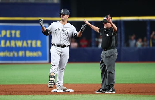 Sep 24, 2019; St. Petersburg, FL, USA; New York Yankees first baseman Mike Ford (36) reacts after a double during the twelfth inning against the Tampa Bay Rays at Tropicana Field. Mandatory Credit: Kim Klement-USA TODAY Sports