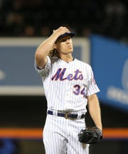Sep 24, 2019; New York City, NY, USA; New York Mets starting pitcher Noah Syndergaard (34) reacts in between pitches against the Miami Marlins during the second inning at Citi Field.