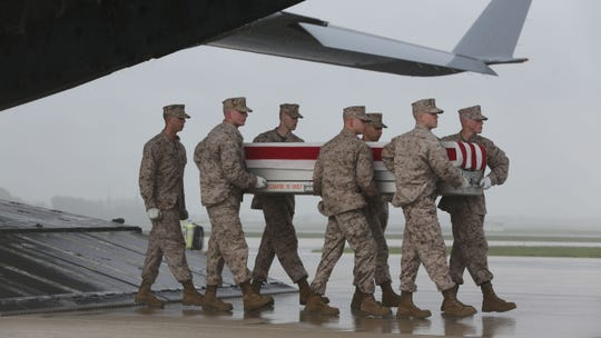 On May 7,  2013 the casket containing the remains of Marine Staff Sgt. Eric Christian, killed in Afghanistan, arrives at Dover Air Force Base. Christian's home town was Ramsey. Marines carried the remains off the plane as part of the Dignified Transfer.