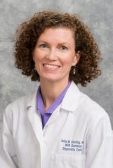 Dr. Delia Keating is a radiologist specializing in breast cancer screening at Memorial Sloan Kettering Cancer Center.