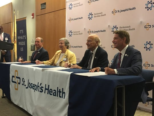 Officials from St. Joseph's Health and Hackensack Meridian Health signed a partnership agreement Wednesday.