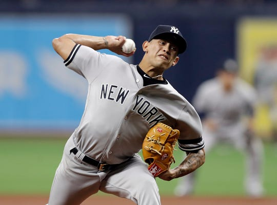 New York Yankees' Jonathan Loaisiga pitches to the Tampa Bay Rays during the first inning of a game Wednesday, Sept. 25, 2019, in St. Petersburg, Fla.