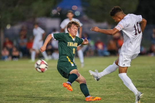 Senior Will Hanson attacks the ball at a boys soccer match between the Mayfield Trojans and the Gadsden Panthers at the Field of Dreams Soccer Complex in Las Cruces on Tuesday, Sept. 24, 2019.