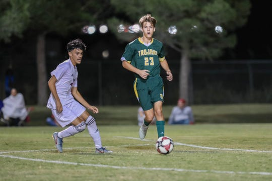 Senior Chase Biad  fends off an opposing player at a boys soccer match between the Mayfield Trojans and the Gadsden Panthers at the Field of Dreams Soccer Complex in Las Cruces on Tuesday, Sept. 24, 2019.