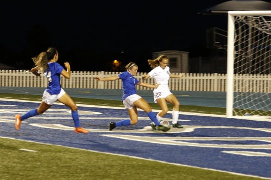 Calsbad's Alexa Dugan gets a shot off for a goal against Alamogordo's Lindsey Norwood during their match on Sept. 24, 2019 in the second half.  Carlsbad won in overtime, 3-2.