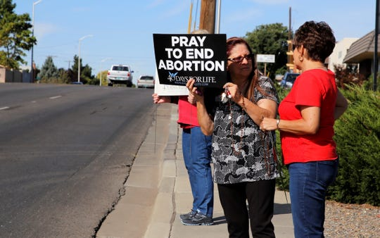Roselie Valdez speaks with Lourdes Salazar Sept. 25 during the 40 Days for Life protests in Farmington. Valdez said abortion is a subject close to her heart because she adopted two sons from Catholic Social Services.