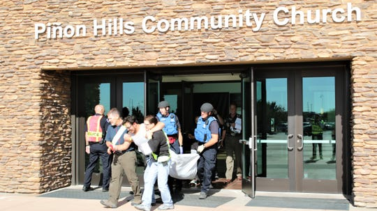 Actors playing victims of an active shooter are taken out of Piñon Hills Community Church.