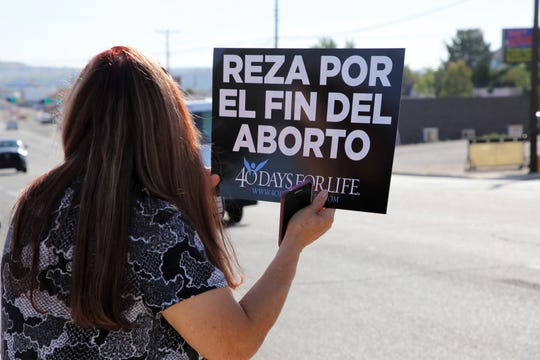 "Lourdes Salazar participates in the first day of the 40 Days for Life protests in front of Planned Parenthood of Farmington. Her sign translates to ""pray for the end of abortion."""