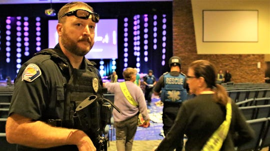 A Farmington police officer participates in an active shooter drill at Piñon Hills Community Church.